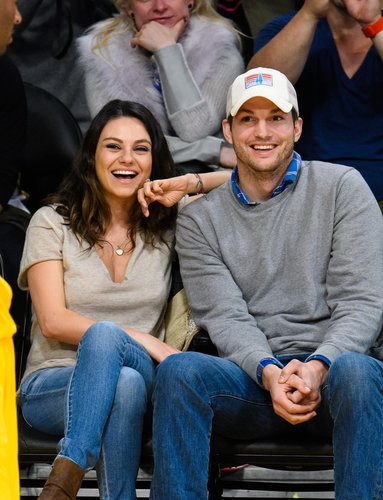 Mila Kunis and Ashton Kutcher attend a basketball game between the Oklahoma City Thunder and the Los Angeles Lakers at Staples Center on December 19, 2014 in Los Angeles