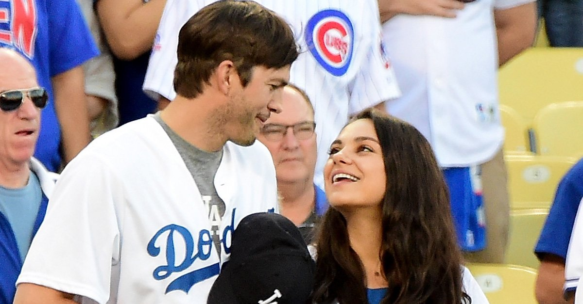 Ashton Kutcher and Mila Kunis on the field after they announced the Los Angeles Dodgers starting lineup before game four of the National League Championship Series againt the Chicago Cubs at Dodger Stadium on October 19, 2016 in Los Angeles