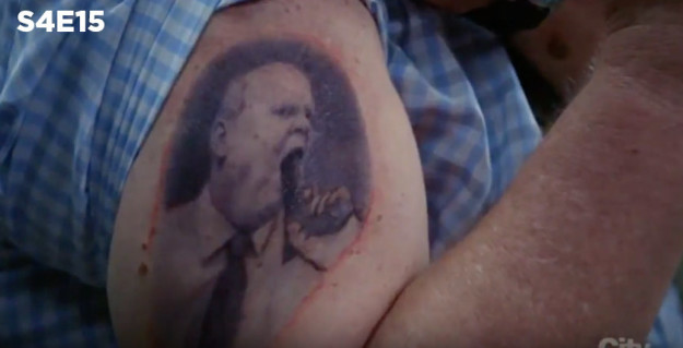 ...It's a callback to the previous season, when he gets the episode to show how cool he is — he thinks it's a tattoo of him blowing smoke off the gun barrel.