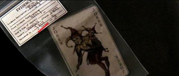"The joker card that Jim Gordon hands to Batman at the end of Batman Begins was recovered by an officer named ""J. Kerr,"" a common alias used by the Joker."