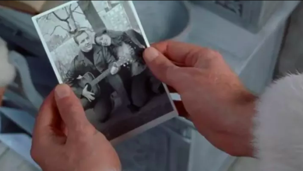 When Buddy learns he was adopted and not technically an elf, he's shown a picture of his real parents which is when he learns his mother is already dead.