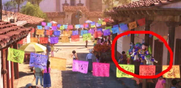 In Coco, there are Buzz and Woody toys hanging in the town streets.